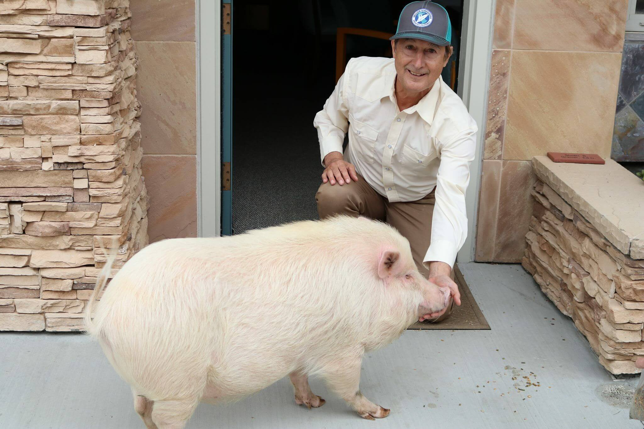 dr stuart grauer with a cute piggy friend