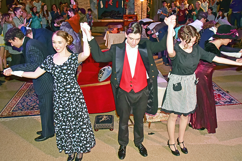 students receiving a standing ovation at the end of a play