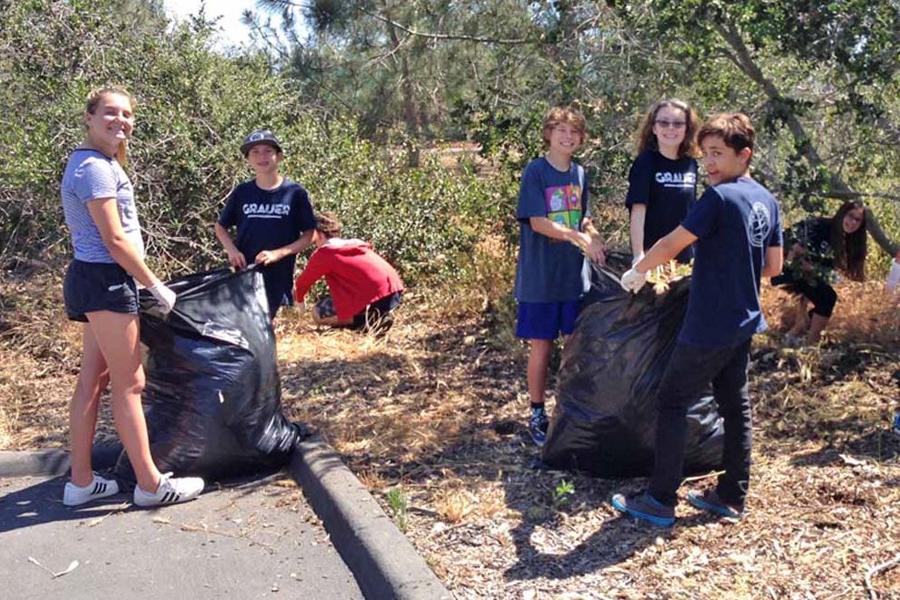 a group of students participating in a community clean up effort
