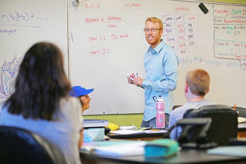 a math teacher guiding his students