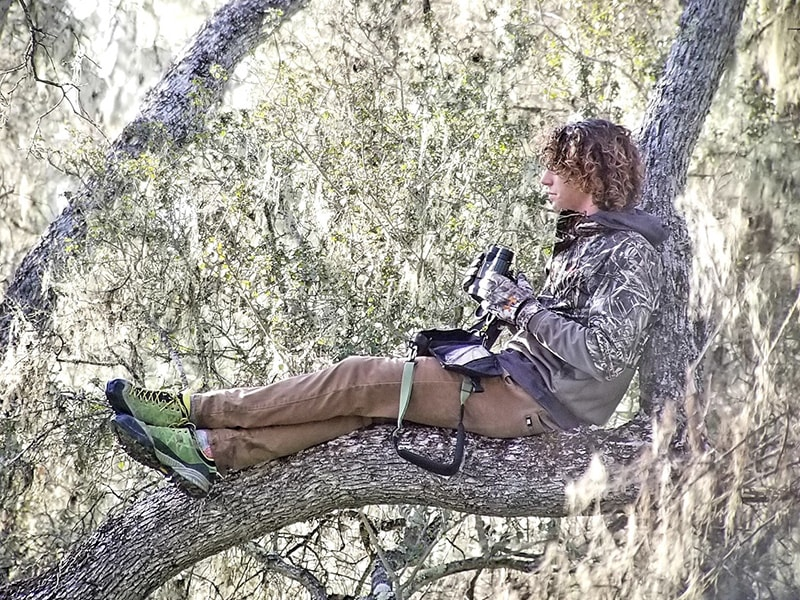 "Grauer junior Emerson S. relaxing in a tree on the ""Back to Our Roots"" Expedition - March 23, 2019"