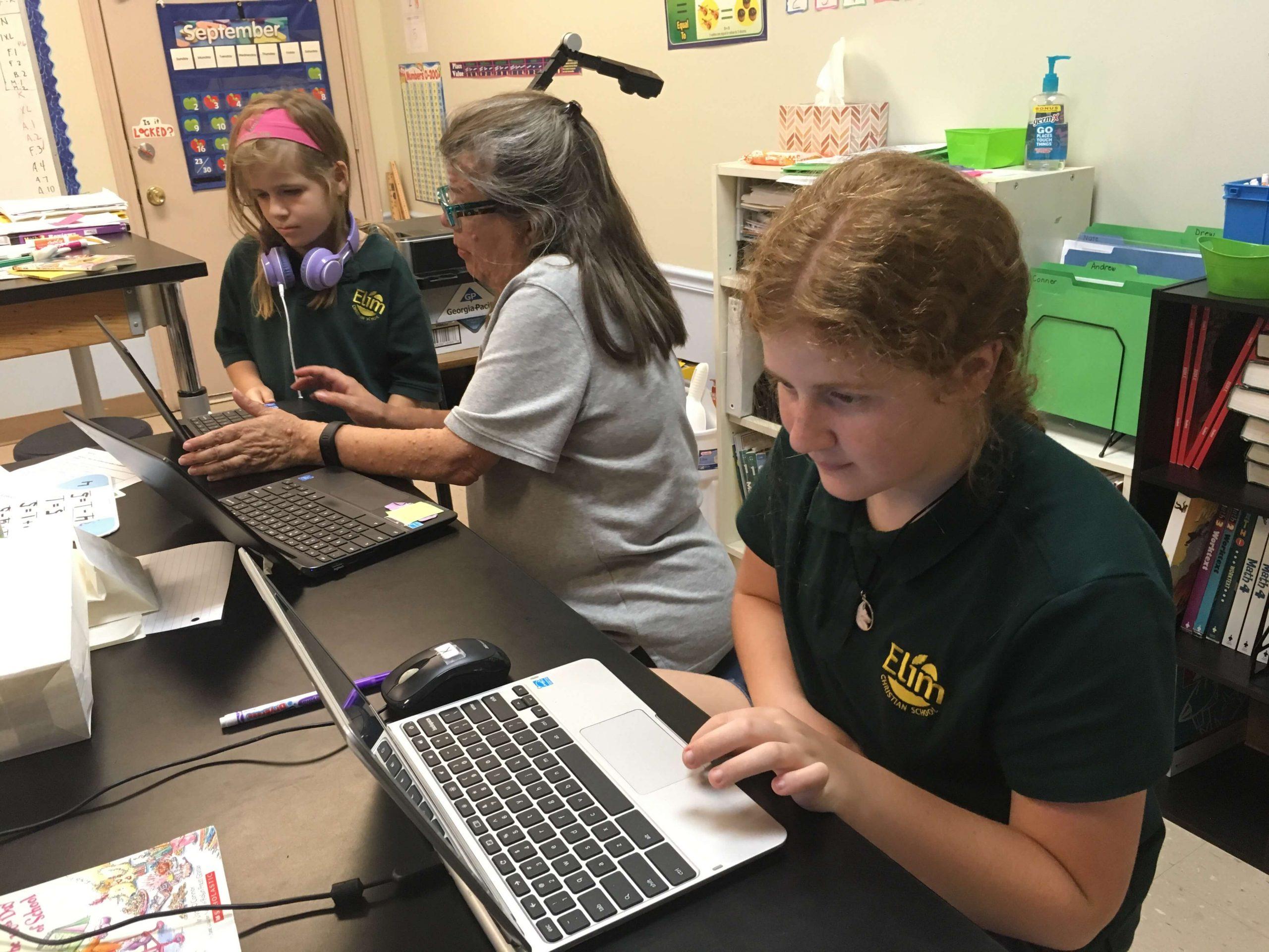 elim christian school students working on laptops